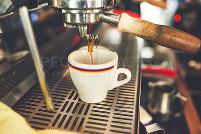 Buy stock photo Cropped shot of coffee being poured from a machine into a cup inside of a coffee shop during the day