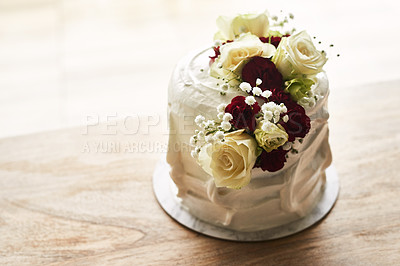 Buy stock photo Still life shot of a beautiful wedding cake on top of a wooden surface