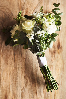 Buy stock photo Still life shot of a beautiful bouquet on top of a wooden surface