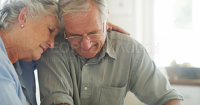Buy stock photo Shot of a senior woman comforting her husband at home