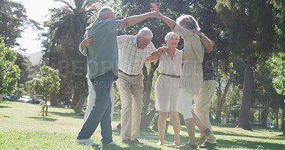 Buy stock photo Full length shot of a group of senior friends embracing each other in a circle in a park