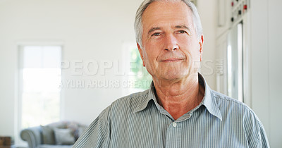 Buy stock photo Portrait of a confident senior man relaxing at home