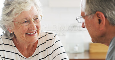 Buy stock photo Shot of a happy senior couple chatting at home