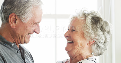 Buy stock photo Shot of a happy senior couple spending quality time together at home