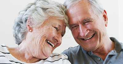 Buy stock photo Shot of a happy senior couple relaxing together at home