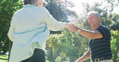 Buy stock photo Cropped shot of an affectionate senior couple dancing together in a park during the day
