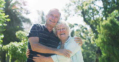 Buy stock photo Cropped portrait of an affectionate senior couple embracing each other while standing in a park during the day