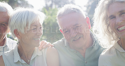 Buy stock photo Closeup shot of a group of senior friends smiling while standing together in a park