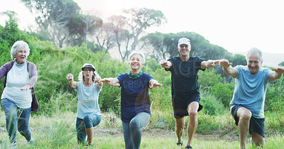 Buy stock photo Cropped shot of a group of cheerful senior friends working out together outdoors