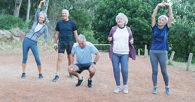 Buy stock photo Full length shot of a group of cheerful senior friends working out together outdoors