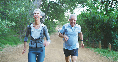 Buy stock photo Cropped shot of a cheerful senior couple going out for a run outdoors during the day