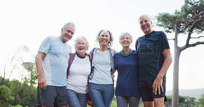Buy stock photo Cropped portrait of a group of cheerful senior friends embracing each other while out for a workout in a park