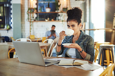 Buy stock photo Cropped shot of an attractive young businesswoman sitting in a cafe and drinking a cup of coffee