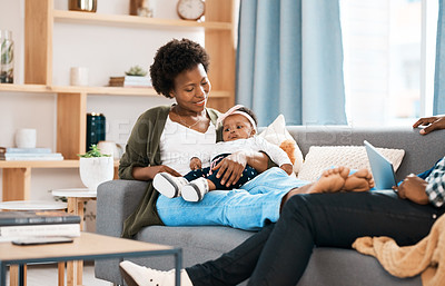 Buy stock photo Shot of a mother bonding with her baby girl at home