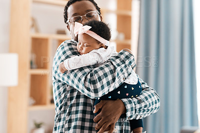 Buy stock photo Shot of a father spending quality time with his baby girl at home