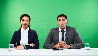 Buy stock photo Cropped shot of two young news anchors delivering the latest news against a green background