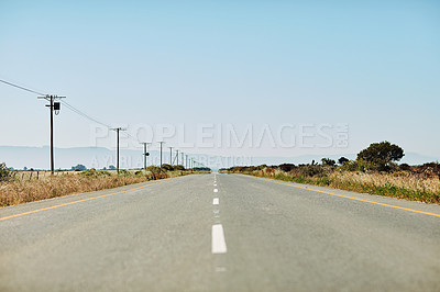 Buy stock photo Still life shot of an empty country road during the day
