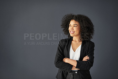 Buy stock photo Studio shot of an attractive young corporate businesswoman posing with her arms folded against a grey background