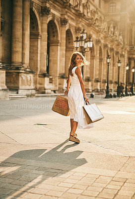 Buy stock photo Portrait of a beautiful young woman out on a shopping spree in the city of Paris