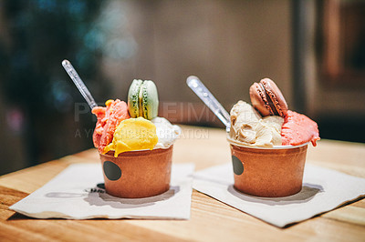 Buy stock photo Still life shot of two delicious sweet treats on a table inside a bakery