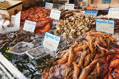 Buy stock photo Shot of freshly caught lobsters, periwinkle and other sea food delicacies at a fish market in Paris, France