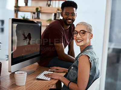 Buy stock photo Portrait of an attractive young creative businesswoman working on a computer inside an office with her colleague in the background