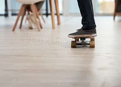 Buy stock photo Cropped shot of an unrecognizable businessman riding his skateboard inside a office
