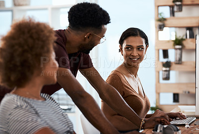Buy stock photo Shot of a group of creative young businesspeople working together inside a modern office