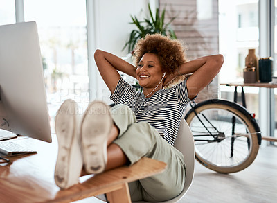 Buy stock photo Full length shot of an attractive young businesswoman relaxing and watching videos on her computer inside her office