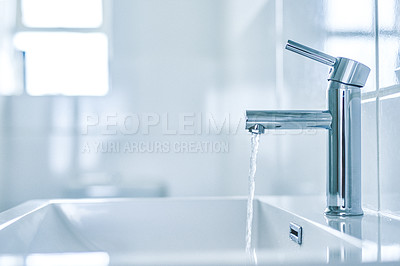 Buy stock photo Shot of an open tap with running water in a bathroom at home