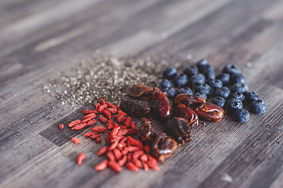 Buy stock photo Shot of a bunch of super foods laying on a wooden background