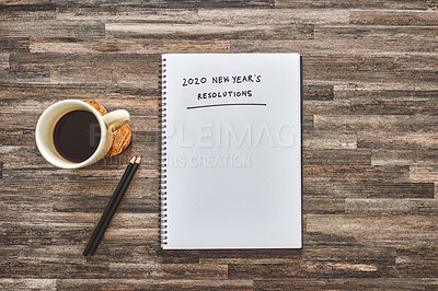 """Buy stock photo Shot of coffee, stationary and a notebook with the words """"2020 new year's resolutions"""" written on it"""