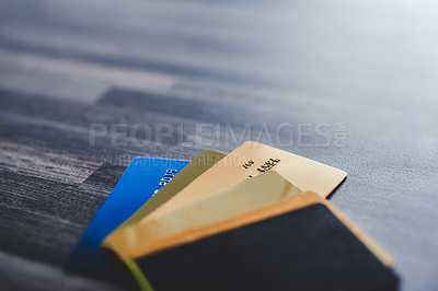 Buy stock photo Shot of multiple bank cards laying on a wooden background