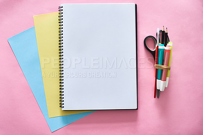 Buy stock photo Shot of a notebook and various tools at a creative workstation