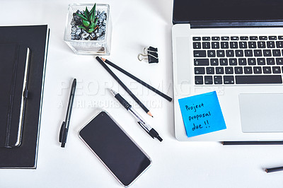 "Buy stock photo Shot of a laptop and sticky note saying ""project proposal due"" stuck to it at a work desk"