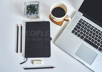 Buy stock photo High angle shot of a laptop and various other business tools on a work desk