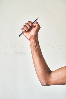 Buy stock photo Cropped shot of an unrecognizable sportsman lifting a pencil against a grey background