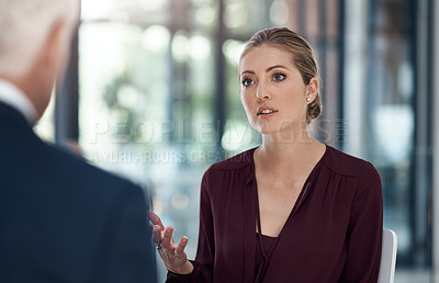 Buy stock photo Shot of a businessman and businesswoman having discussion in a modern office