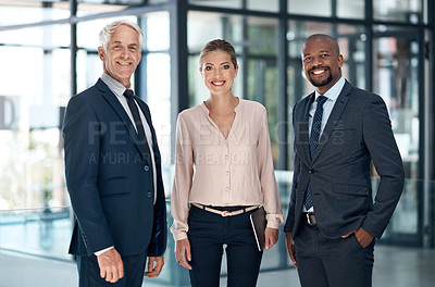 Buy stock photo Portrait of a group of confident businesspeople working together in a modern office