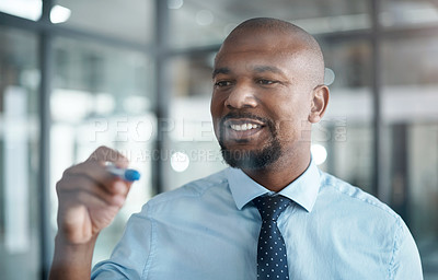 Buy stock photo Shot of a confident businessman having a brainstorming session in a modern office