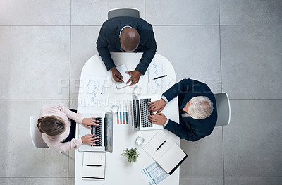 Buy stock photo High angle shot of a group of businesspeople having a meeting in an office