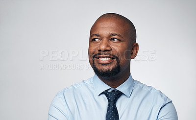 Buy stock photo Shot of a mature businessman looking thoughtful against a grey background