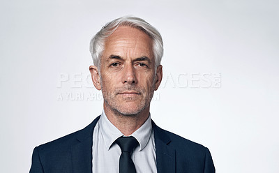 Buy stock photo Portrait of a mature businessman against a grey background