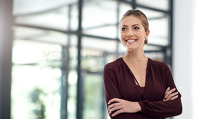Buy stock photo Shot of a young businesswoman looking thoughtful while standing in an office