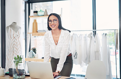 Buy stock photo Shot of a young business owner using a laptop in her store