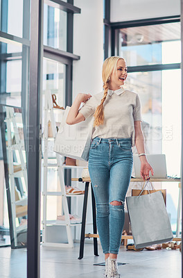 Buy stock photo Shot of an attractive young woman carrying shopping bags