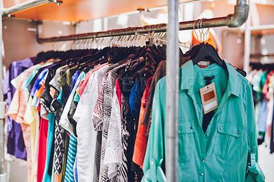 Buy stock photo Shot of clothes hanging on a rack in a thrift store