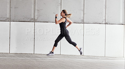 Buy stock photo Portrait of a sporty young woman running outdoors