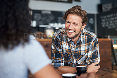 Buy stock photo Defocused shot of two people having coffee together at a cafe
