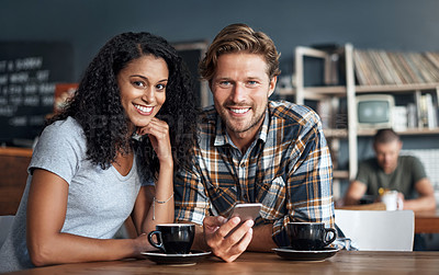 Buy stock photo Cropped shot of a young couple having coffee together at a cafe